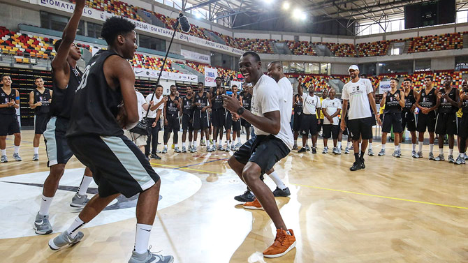 Developing African Sports: Dikembe Mutombo Re-Unites Bismack Biyombo With His Roots While Basketball Without Borders Awards Two Young Angolan Athletes U.S. Scholarships